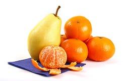 Mandarins and pear Royalty Free Stock Photography