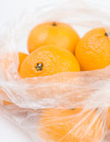 Mandarins in the polyethylene bag Royalty Free Stock Photography