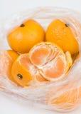 Mandarins in the polyethylene bag Royalty Free Stock Photography