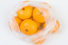 Mandarins in the polyethylene bag. Mandarins in the opened polyethylene bag  closeup isolated Stock Photography