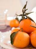 Mandarins with sheets Royalty Free Stock Photo