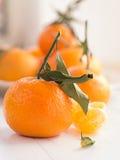 Mandarins with sheets Stock Photos
