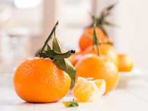 Mandarins with sheets Royalty Free Stock Photos