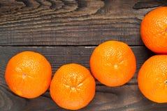 Mandarins. Some ripe big mandarin on wooden tabble Stock Photos