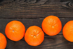 Mandarins. Some ripe big mandarin on wooden tabble Stock Images