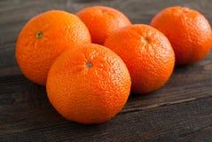 Mandarins. Some ripe big mandarin on wooden tabble Stock Image
