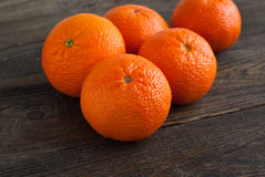 Mandarins. Some ripe big mandarin on wooden tabble Royalty Free Stock Photography