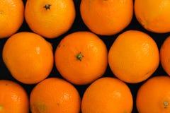 Mandarins on the table Stock Photos