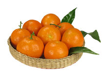Mandarins in the wicker basket Stock Photo