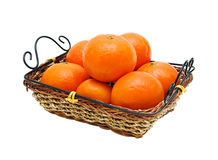 Mandarins in the wicker basket. On a white background Royalty Free Stock Photos