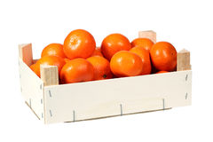 Mandarins in wooden box Stock Images