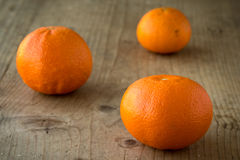 Mandarins on wooden table Royalty Free Stock Photography