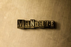 MANDATE - close-up of grungy vintage typeset word on metal backdrop. Royalty free stock - 3D rendered stock image.  Can be used for online banner ads and Royalty Free Stock Photography