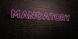 MANDATORY -Realistic Neon Sign on Brick Wall background - 3D rendered royalty free stock image Royalty Free Stock Photos
