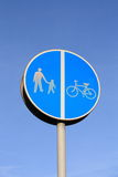 Footpath left, cycle-lane right sign. Royalty Free Stock Image