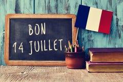 Mande un SMS al juillet del bon 14, feliz el 14 de julio en francés Fotografía de archivo libre de regalías