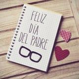 Mande un SMS a feliz dia del padre, día de padres feliz en español Fotos de archivo libres de regalías