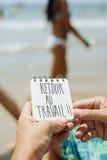 Mande un SMS a la dificultad del au del retour, de nuevo a trabajo en francés fotografía de archivo libre de regalías