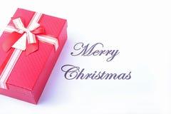 Mande un SMS a la Feliz Navidad en el papel con muchas bolas y cajas de regalo Imagen de archivo libre de regalías