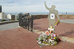 Mandela cut out. A Stainless steel cut out of Nelson Mandela with flowers after his death Stock Photo
