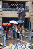 Mandela memorial day. People gather and lay flowers in Nelson Mandela Square in Sandton city, on a very wet day in Johannesburg. This on the memorial day of Stock Image