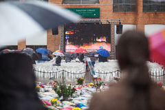 Mandela memorial day. People gather and lay flowers in Nelson Mandela Square in Sandton city, on a very wet day in Johannesburg. This on the memorial day of Royalty Free Stock Photography