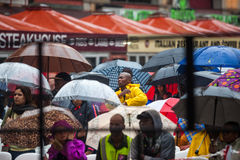 Mandela memorial day. People gather and lay flowers in Nelson Mandela Square in Sandton city, on a very wet day in Johannesburg. This on the memorial day of Stock Photography