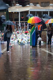 Mandela memorial day. People gather and lay flowers in Nelson Mandela Square in Sandton city, on a very wet day in Johannesburg. This on the memorial day of Stock Photos