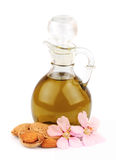 Mandelöl und Mandelmuttern mit Blumen Lizenzfreies Stockbild