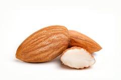 Mandelnüsse mit weißem Hintergrund Lizenzfreie Stockfotografie