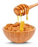 Mandelnüsse und -honig Lizenzfreie Stockfotos