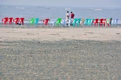 Colourful chairs at mandermoni sea beach