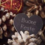 Mandi un sms al feste di buone, feste felici in italiano Fotografia Stock