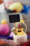 Mandi un sms al pascua del feliz, pasqua felice nello Spagnolo Fotografie Stock