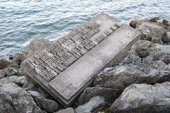 Mandi un sms alla scultura lungo lungomare di Wellington, isola del nord della Nuova Zelanda Fotografie Stock