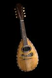 Mandolin. String acoustic instrument on black background stock photography