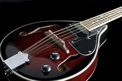 Mandolin on a Black Background. A mandolin on a black background in the horizontal or landscape view Stock Images
