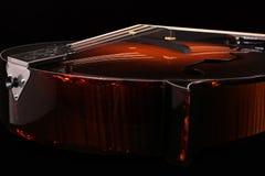 Mandolin detail on black background. Mandolin isolated on black background Stock Image