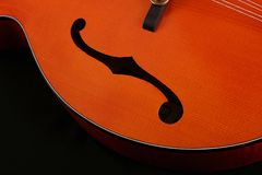 Mandolin detail on black background Royalty Free Stock Images