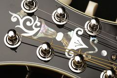 Mandolin detail on black background Royalty Free Stock Image