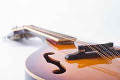 Mandolin detail on white background. Detail photo of bluegrass mandolin on white background Stock Photos