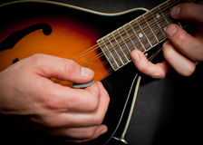 Mandolin hands. Close up of a mans hands , playing the mandolin Royalty Free Stock Image