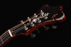 Mandolin isolated on black background. Mandolin detail isolated on black background Stock Photo