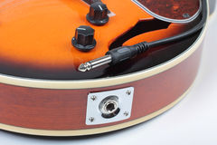 Mandolin and plug Stock Images