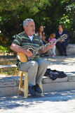 Mandolin street singer Stock Images