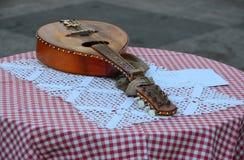 Mandolina na stole Zdjęcia Stock