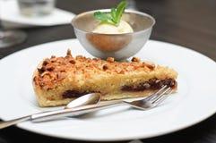Mandorle e torta del cioccolato Fotografia Stock