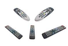 Mandos a distancia de la TV aislados con la corrección del recortes Foto de archivo