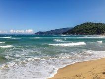 Mandraki beach, Skiathos, Greece. Waves of the Aegean sea crash down on Mandraki beach, Skiathos, Greece royalty free stock photos