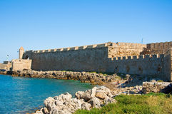 Mandraki harbor and the beach, Rhodes, Greece. Stock Photos